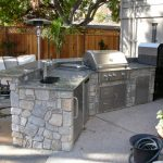 Outdoor kitchen with a gas grill and smoker