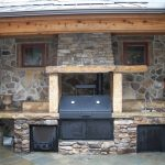 Rustic San Jose outdoor kitchen with a smoker and sink