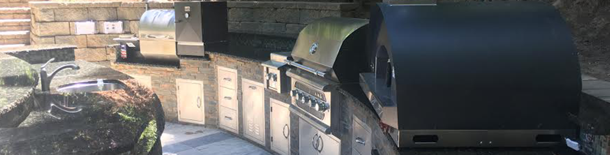 Outdoor kitchen in the San Jose area with grill, smoker, side burner and pizza oven