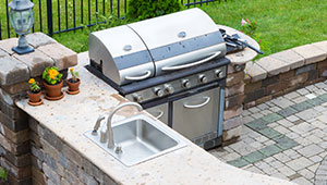 sink and stainless steel grill outside